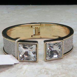 Bebe gold hinged sparkly bracelet with rhinestones